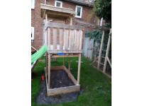 Big climbing frame with swing and slide