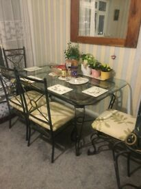 Solid metal dining table with chairs and dresser