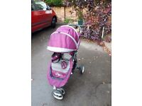 Baby Jogger City Mini pushcair with rain cover and footmuff.
