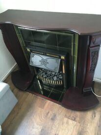Beautiful Mahogany fire surround with electric insert fire