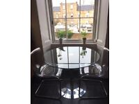 Round, glass John Lewis table and 2 Perspex ikea chairs