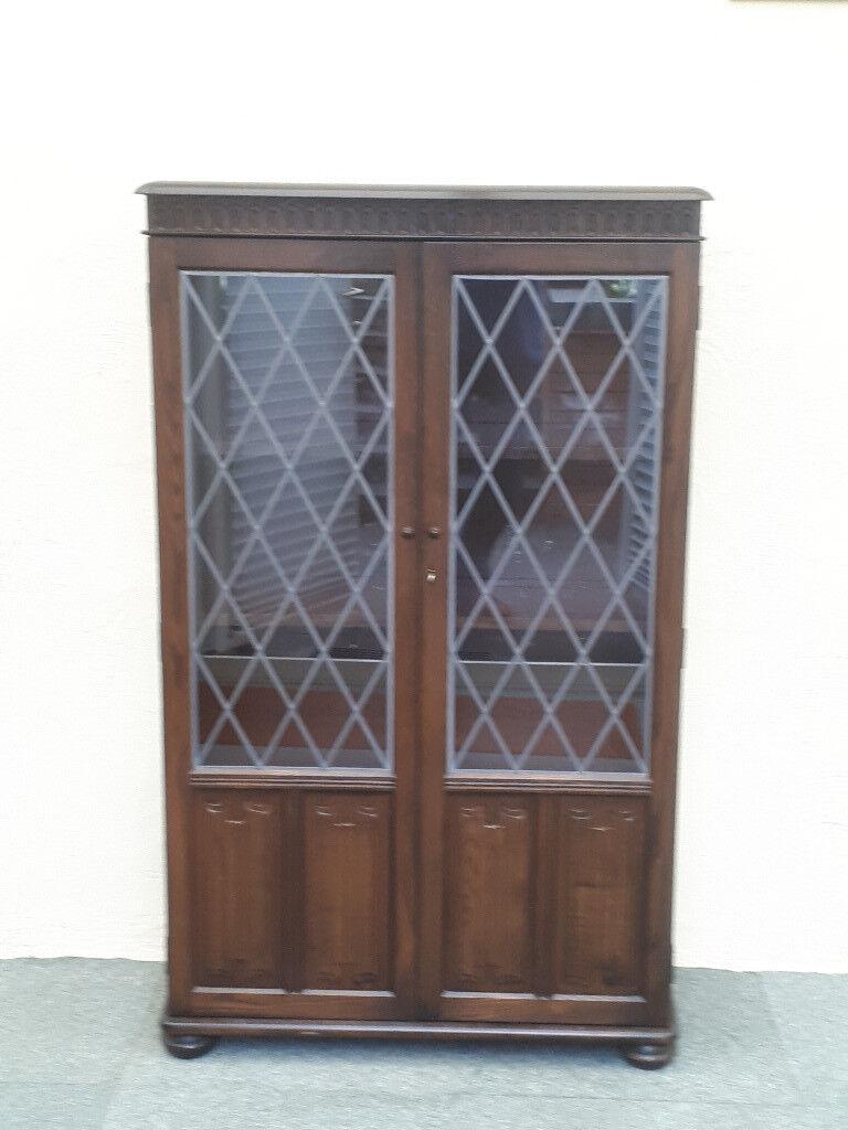 Dark Wood Display Cabinet With Gl Leaded Doors