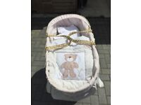 Moses basket and extra bedding.