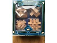 Set of four wooden puzzles