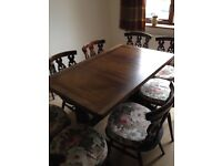 Ercol extendable table and 8 chairs.
