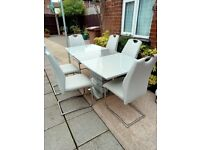 Extendable kitchen table with 6 grey leather chairs