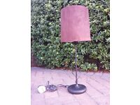 An ornate faux suede brown semi-standard lamp