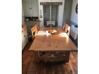 Solid oak dining table with four chairs and two benches very large