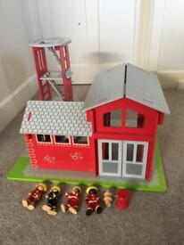 Toy fire station with mini figures