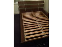 Solid wood IKEA King size bed. Very heavy piece of furniture in good condition.
