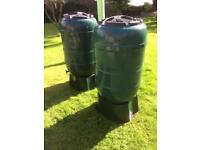 Two large water butts with tap & stand