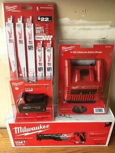 NEW MILWAUKEE SAWZALL KIT W/ battery , charger  and blades $ $150 firm