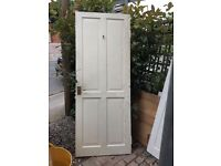 3 white wooden doors