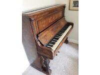 Piano. Antique with original ivory keys