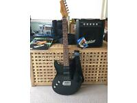 Left hand 3/4 size Ashton electric guitar, Ashton Amp, Kinsman guitar case, Grade 1 music book