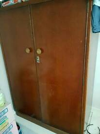 Oak cabinet with shelves, hanger and lockable