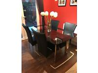 Black glass dining table and 4 leather chairs