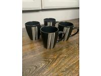 Set of 4 Argos black and white striped cups mugs great condition