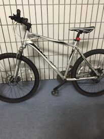Giant revel hard tail mountain bike silver/black front and rear disc brakes good condition