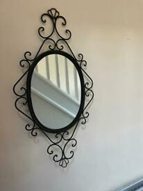 Mirror in a metal frame