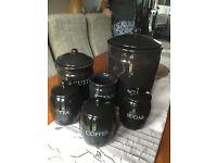 Sat of 6 black ceramic storage jars