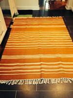 Striped area rug - burnt orange and cream