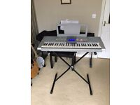 Yamaha PSR-295 Keyboard with stand, dust cover, manual and songbook