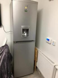 Silver fridge freezer with water dispenser
