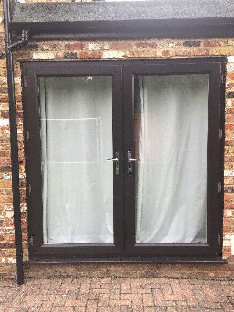 2 Sets Of Upvc Patio Doors Black Frames On Outside White On Inside