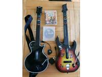 Guitar hero guitars with dongles and two games.