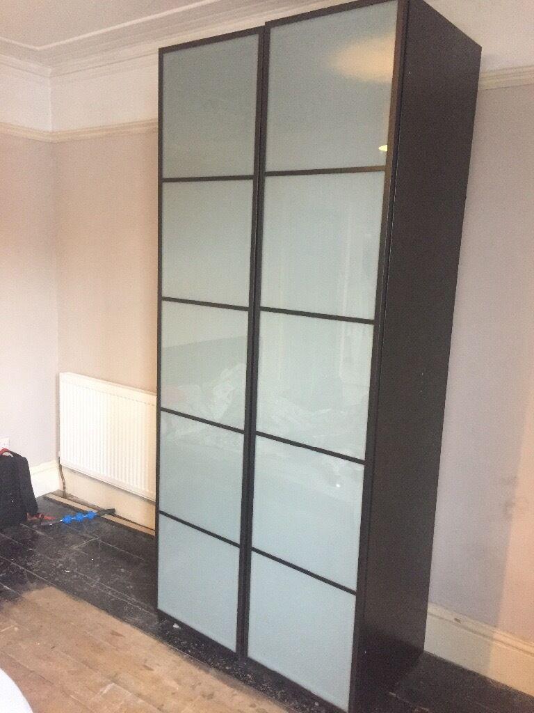 Ikea pax wardrobe fevik doors tall dark wood in for Ikea wood type