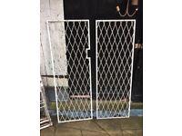 Pair of steel door or window security grilles