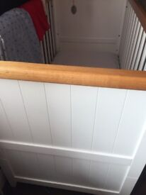 White solid wood cot with mattress