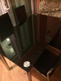 Black dining table with 4X leather chairs. Excellent condition