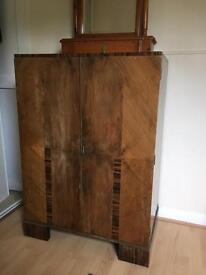 Wooden linen press and mirror