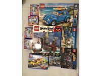 12 lego sets - Lego VW Beetle, lego city, angry bird, friend and duplo