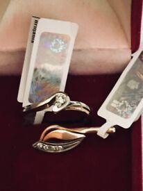 Elegant company Storks Gold diamond ring and golden pendant with diamonds