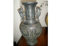 Tall Chinese metal vase with dragon handles.