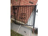 Wrought Iron gate with posts.