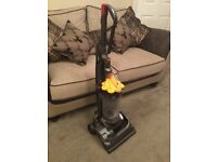 Dyson DC 33 upright vacuum cleaner.
