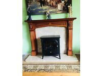 Oak fire surround with marble inlay and hearth.Also electric log effect fire