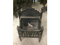 Beautiful antique cast iron fire basket with sun design
