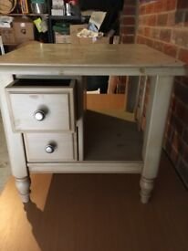 A useful square topped table with two drawers and a shelf.