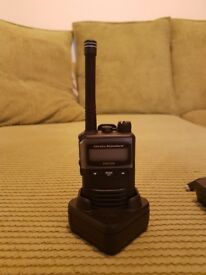 Two black vertex standard evx-s24 radio transcievers both with battery pack and charger