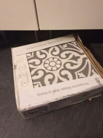 One box of Devonstone Grey floor tiles