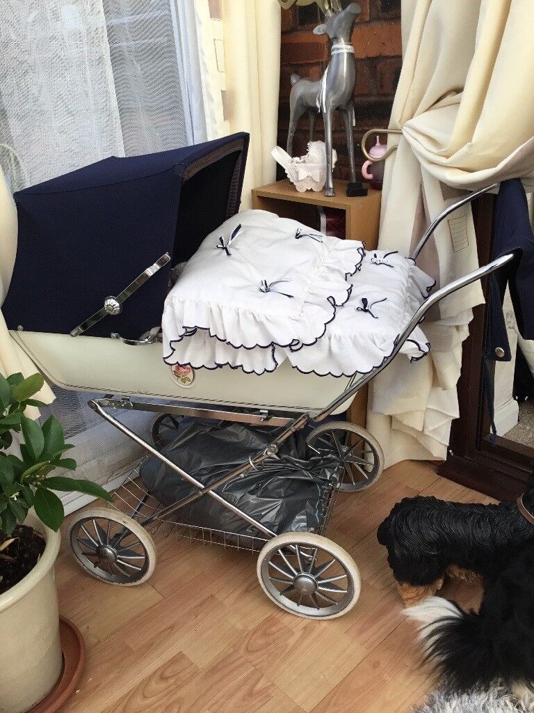Lovely silver cross pram with baby