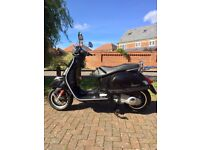 Vespa gts 125 immaculate condition.