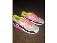 Pink and lime green size 5 women Nike air max