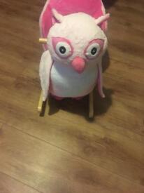 Pink rocking owl