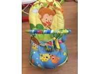 Baby bouncer chair vibrates and plays songs.